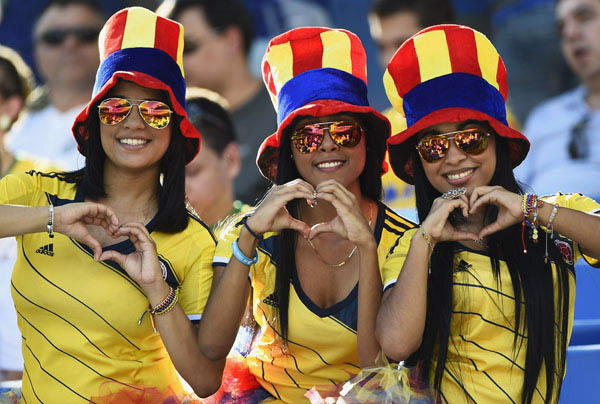 Colombia's fans pose before 2014 World Cup Group C soccer match against Japan at Pantanal arena in Cuiaba