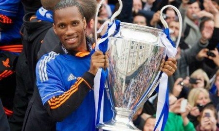 Didier-Drogba-holds-the-Champions-League-and-FA-Cup