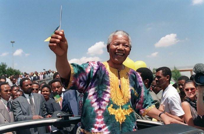 African National Congress (ANC) president Nelson Mandela waves to supporters during an electoral meeting, 29 January 1994 in Johannesburg, as he is campaigning for presidential election. South Africans will vote 27 April 1994 in the country's first democratic and multiracial general elections.